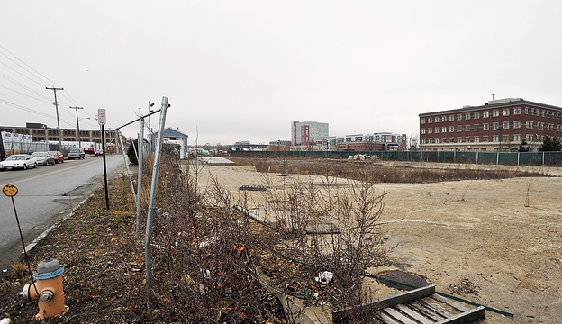 The proposed site of the first phase of the midtown development, viewed down Somerset Street toward Chestnut Street. The Maine Department of Health and Human Services building on Marginal Way is at right.