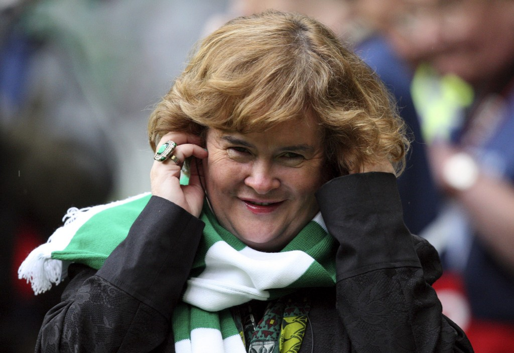 FILE - Susan Boyle performs ahead of the Champions League qualifying second round soccer match between Celtic and Helsingborgs at Celtic Park, Glasgow, Scotland, in this Aug. 29, 2012 file photo. Boyle told the Observer newspaper in an interview published Sunday Dec. 8, 2013, she has been diagnosed with Asperger's syndrome, a form of autism, after seeing a specialist a year ago.