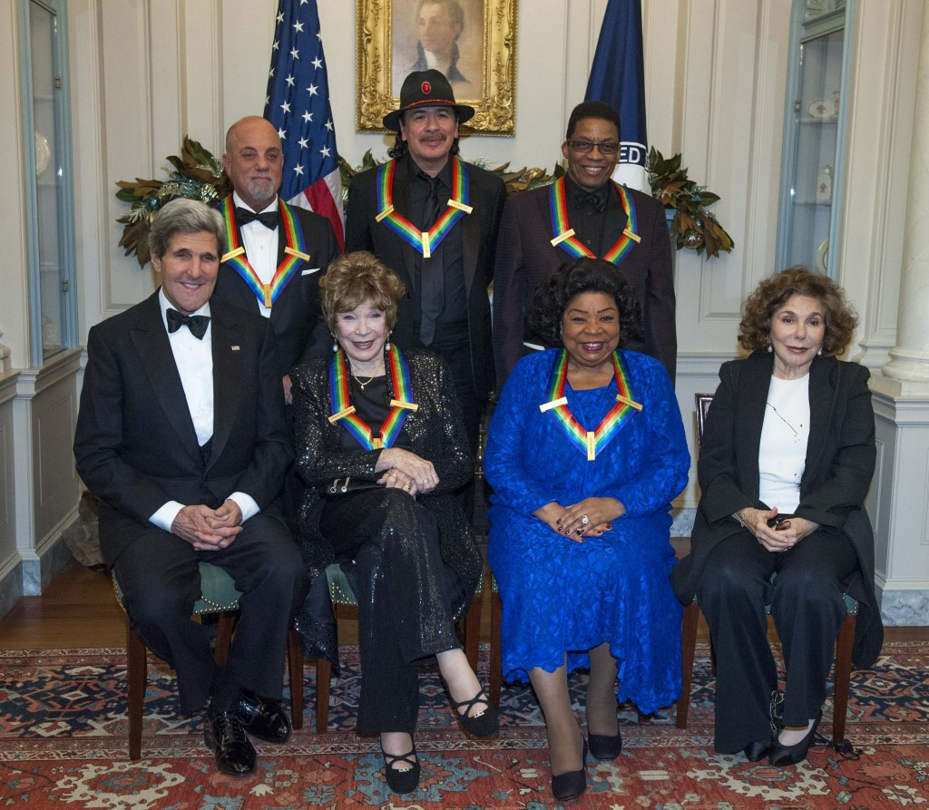 Secretary of State John Kerry, with the 2013 Kennedy Center honorees, from left, seated Shirley MacLaine and Martina Arroyo, along with Teresa Heinz Kerry. Standing are Billy Joel, Carlos Santana, and Herbie Hancock. The Kennedy Center Honors gala dinner was held Saturday in Washington.