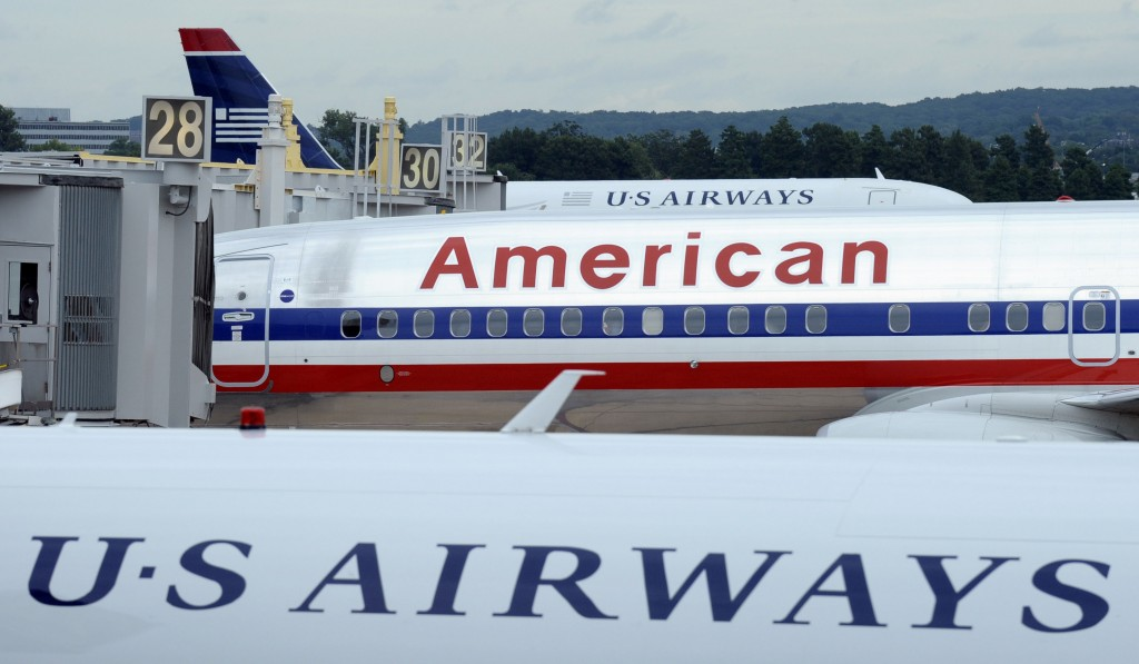 An American Airlines plane sits between two US Airways planes at Washington's Ronald Reagan National Airport. The two airlines have merged.