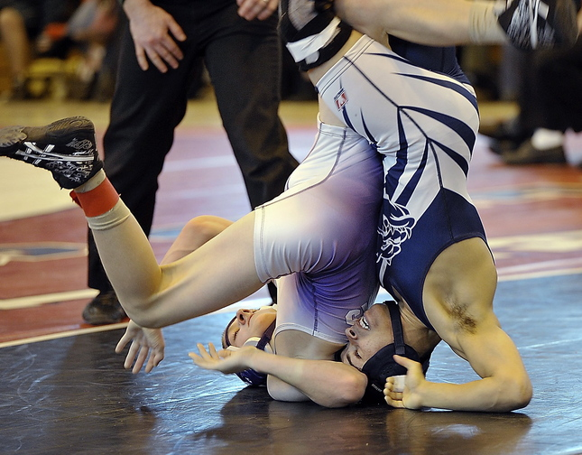 Kidayer Aljubyly of Portland, right, won the Western Class A and state titles at 106 pounds last winter and is a heavy favorite to repeat at the same weight.