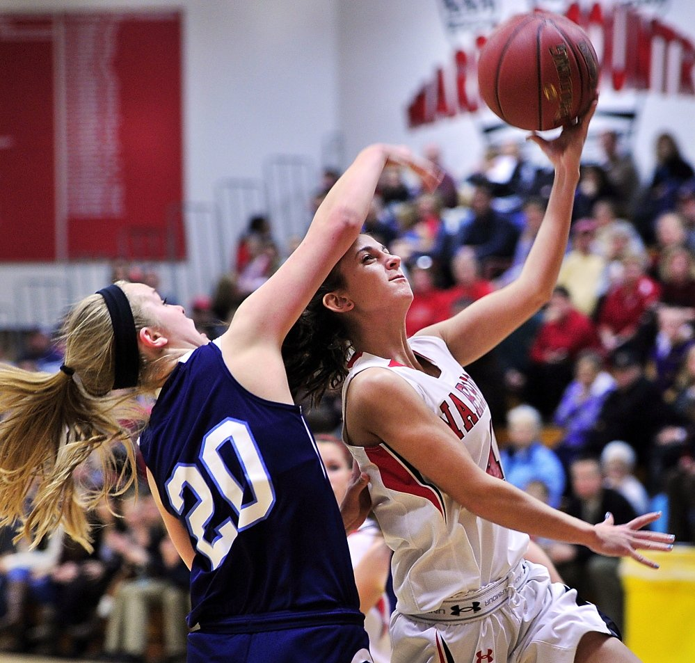 York's Chloe Smedley tries to block a layup by Wells' Syndney LaChapelle. Tuesday, December 10, 2013. Gordon Chibroski/Staff Photographer 281371