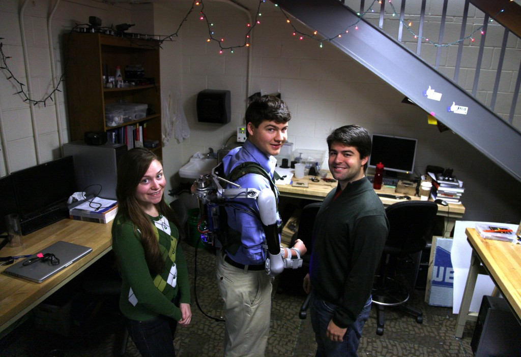 Nick McGill wears the Titan Arm, as he poses alongside his student colleagues Elizabeth Beattie and Nick Parrotta at the University of Pennsylvania in Philadelphia. The robotic device invented along with a fourth student, Niko Vladimiro, builds on existing research in the field of exoskeletons, an area that experts say will grow as the population ages.