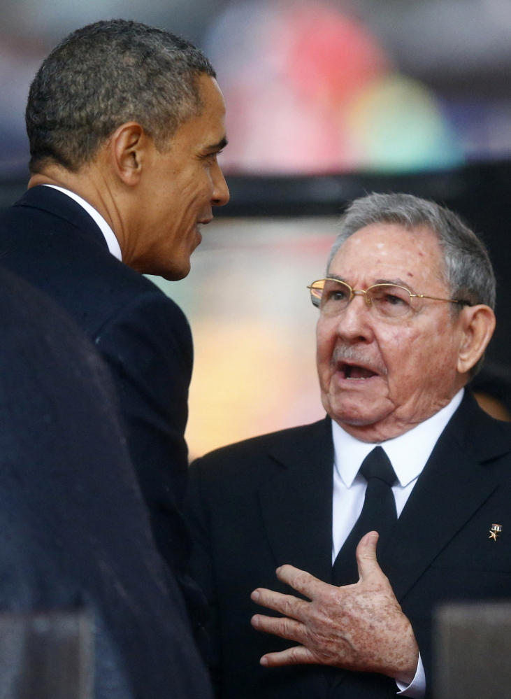 President Obama greets Cuban President Raul Castro before giving his speech.