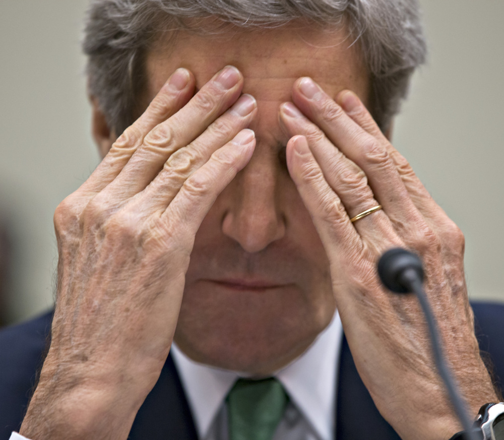 Secretary of State John Kerry pauses while testifying Tuesday before the House Foreign Affairs Committee.
