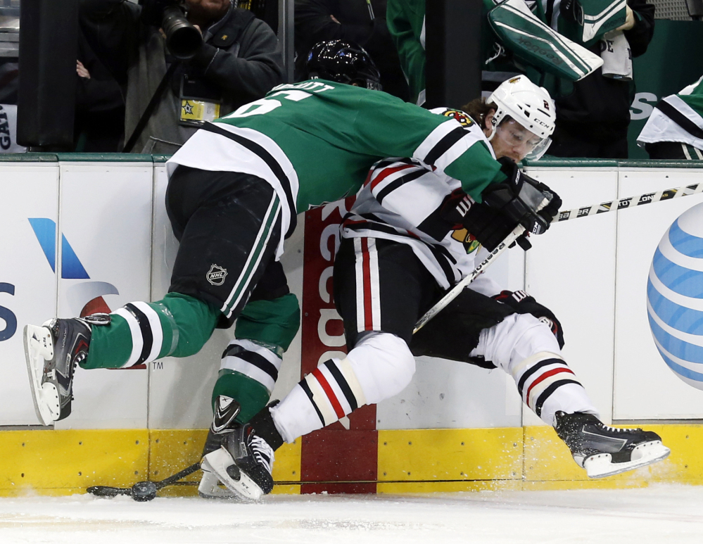 Stars left wing Ryan Garbutt, left, knocks Blackhawks defenseman Duncan Keith to the ice during the first period of Chicago's 6-2 win at Dallas.