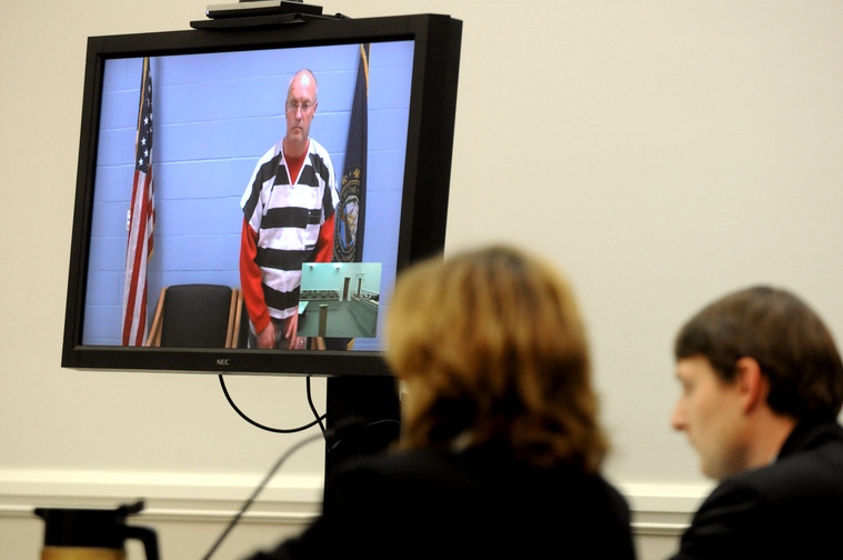 Robert J. Dellinger, 53, of Sunapee, N.H., is arraigned by video at Lebanon District Court in Lebanon, N.H., on Wednesday, on two counts of manslaughter in the deaths of a Wilder, Vt., couple who were killed in an automobile collision on Interstate 89 in Lebanon on Saturday.