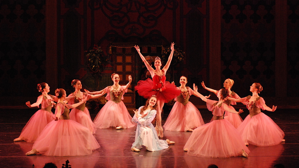 "Amelia Bielen as Rosebud (in red tutu) and Emily Avery as Olivia (traditionally Clara) take center stage in the ""Waltz of the Flowers"" in a prior production."