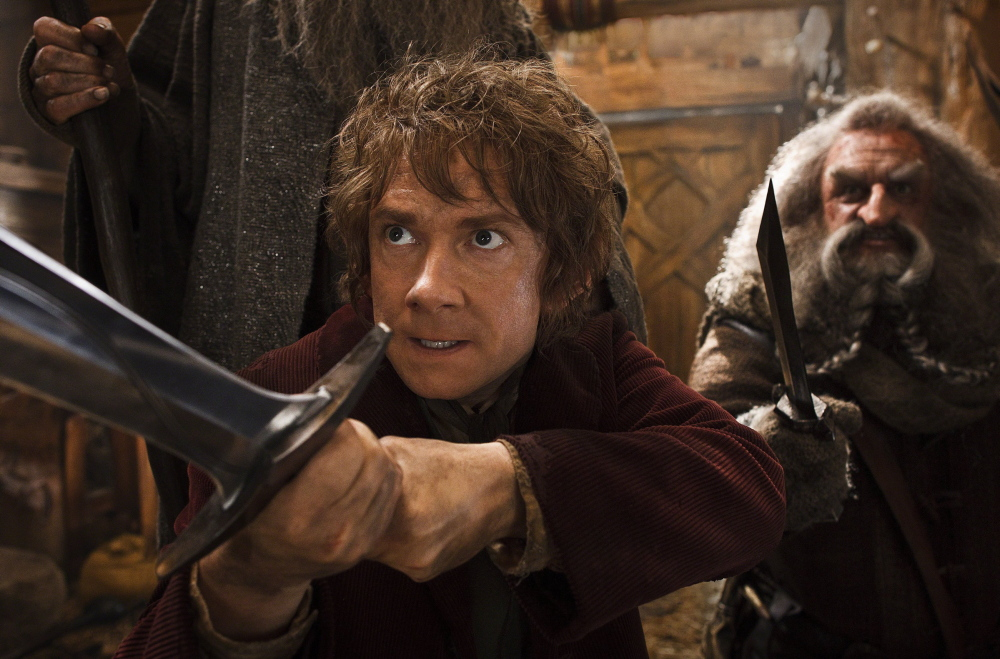 "Martin Freeman as the hobbit Bilbo Baggins, left, and John Callen as the dwarf Oin in ""The Desolation of Smaug."""