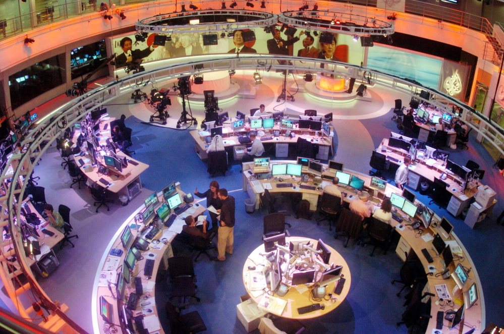 Al Jazeera English Channel staff prepare for the broadcast.