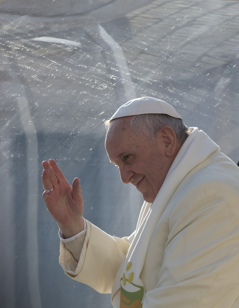 Pope Francis waves as he leaves after his weekly general audience in St. Peter's Square at the Vatican on Wednesday. Pope Francis has been selected by Time magazine as the Person of the Year.