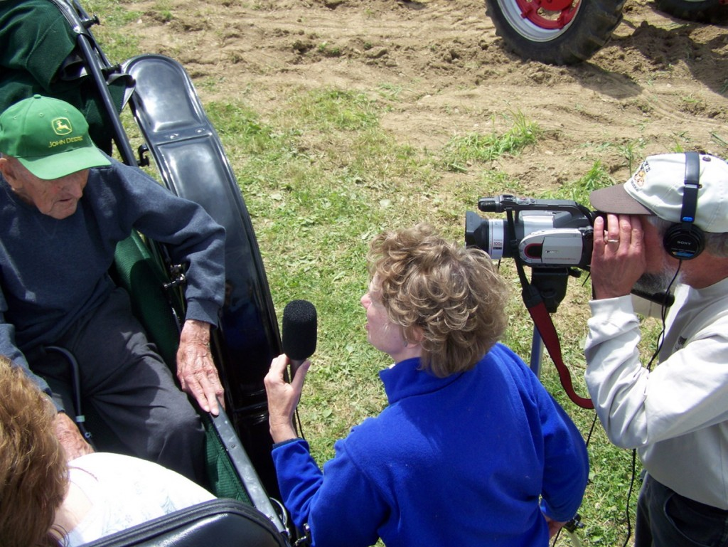 """Self-employed documentary filmmakers Brenda Nasberg Jepson and Alan Jepson interview 95-year-old Rodney Pelkey for a show called """"Maple Meadow Farm"""" shown on Maine Public Broadcasting in May 2013. The Jepsons, residents of Aroostook County, have purchased health insurance made available to them via the Affordable Care Act."""