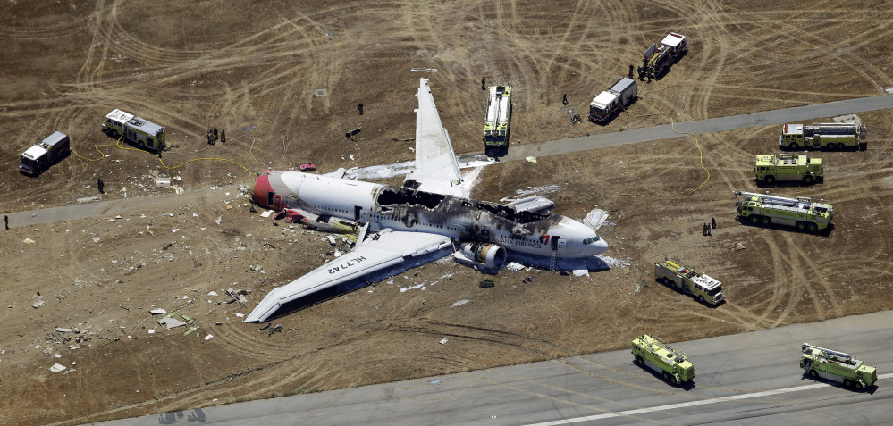 In this Saturday, July 6, 2013, photo, wreckage of the Asiana Flight 214 airplane is seen after it crashed at the San Francisco International Airport in San Francisco.