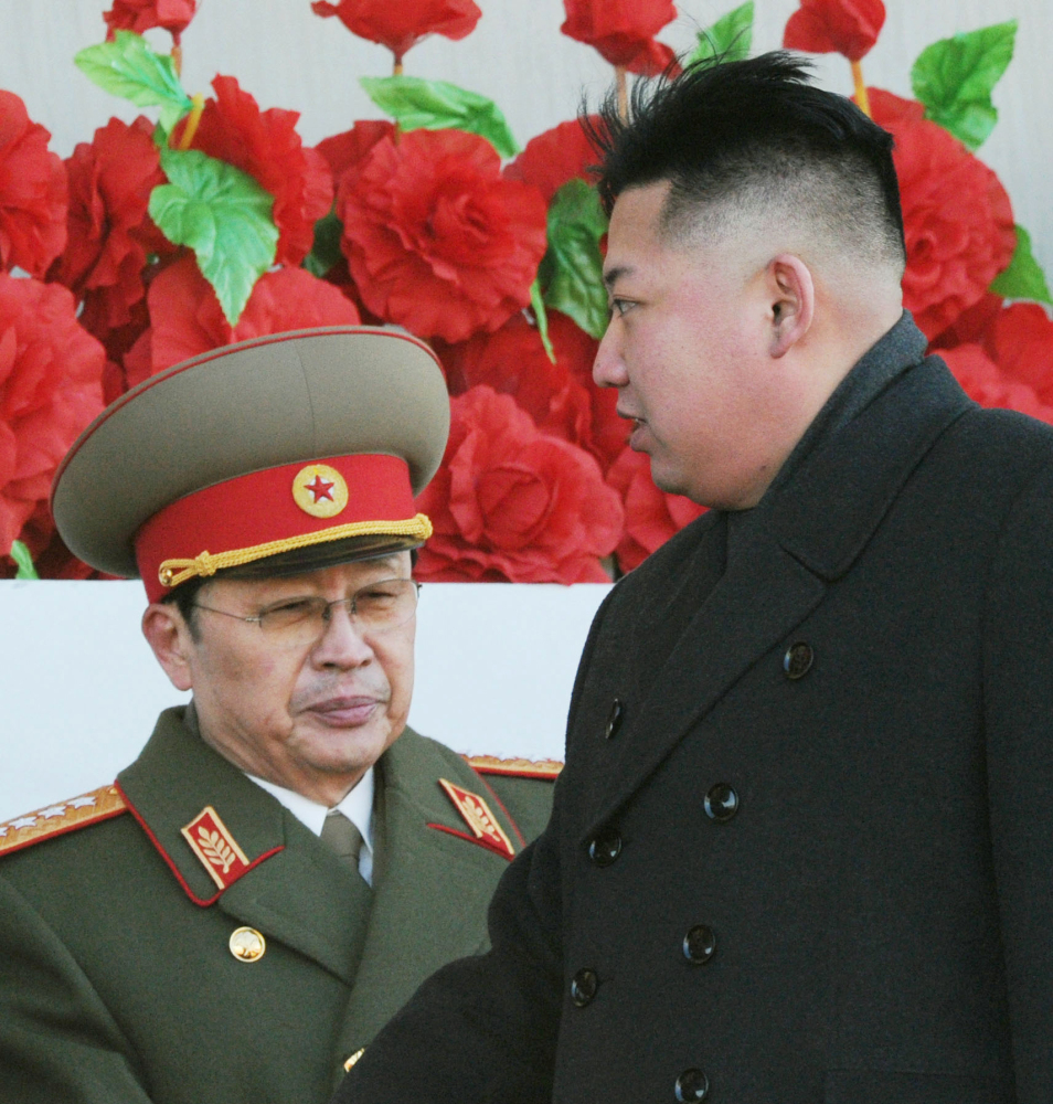 North Korean leader Kim Jong Un walks past his uncle Jang Song Thaek, left, after reviewing a parade of thousands of soldiers and commemorating the 70th birthday of the late Kim Jong Il in Pyongyang, North Korea in 2012. North Korean state media say Jang has been executed.