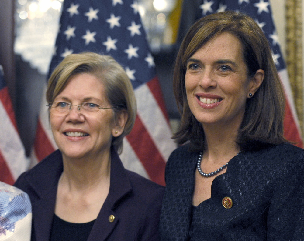 Rep. Katherine Clark, D-Mass., right, stands with Sen. Elizabeth Warren, D-Mass., after Clark posed for a photo Thursday during her ceremonial swearing-in on Capitol Hill in Washington.