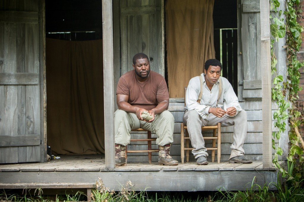 "Director Steve McQueen, left, and actor Chiwetel Ejiofor during the filming of ""12 Years A Slave."" AP Photo/Fox Searchlight"