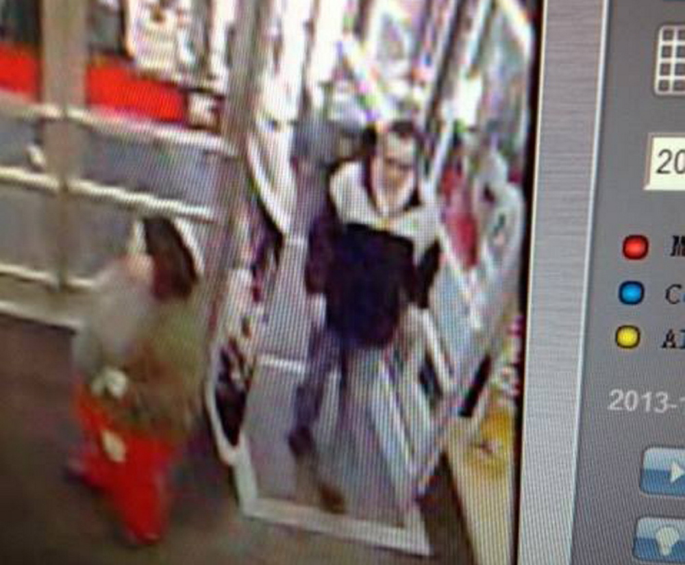 The man seen in this store security camera photo is being sought by police, who said he left Waterville's Kmart with more than $450 in stolen toys on Wednesday.