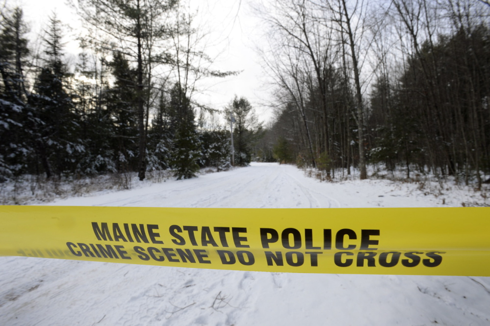 Police tape blocks the driveway at 33 Little Falls Rd. in Hollis, where John Knudsen 61, was shot and killed after he fired at troopers Friday, Dec. 13, 2013. Shawn Patrick Ouellette/Staff Photographer