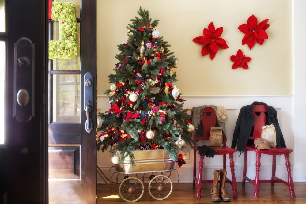 A vintage wagon serves as a mobile tree stand, so this piece of holiday decor can be moved to any room where guests are congregating.