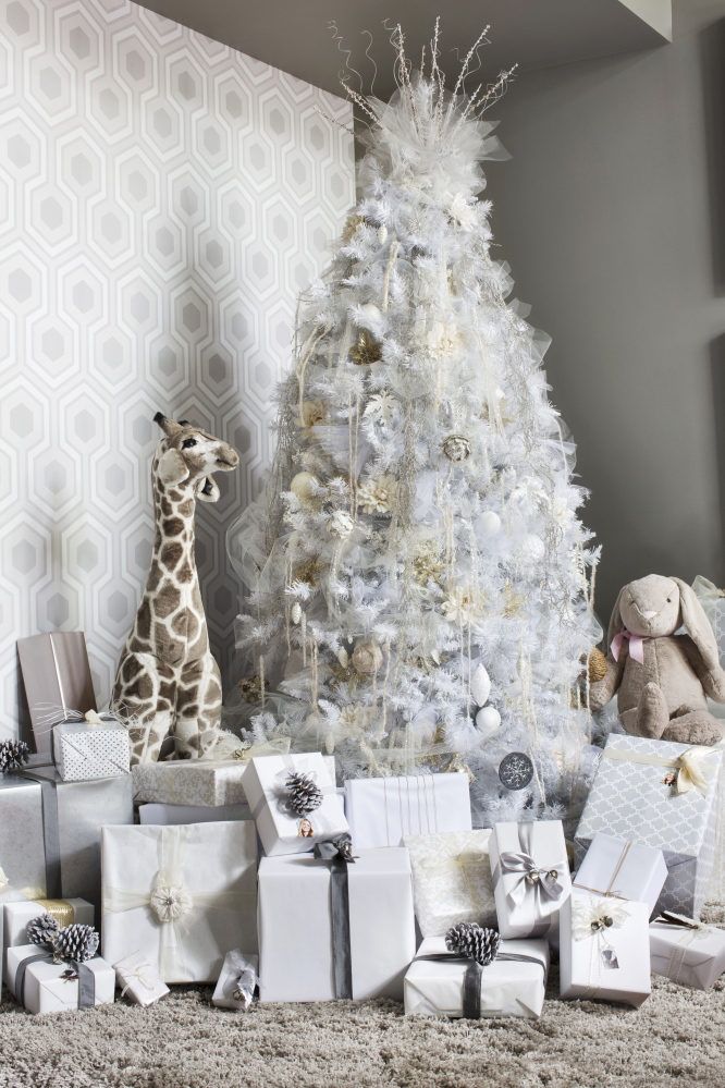 For a creative twist on a traditional Christmas tree, designer Brian Patrick Flynn uses a muted color palette of white, cream, gray and tan for a fresh look that's understated and elegant.