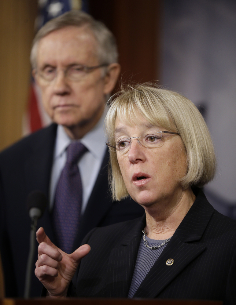 Senate Majority Leader Harry Reid of Nevada listens at left as Senate Budget Committee Chair Sen. Patty Murray, D-Wash., answers questions on the budget Thursday.