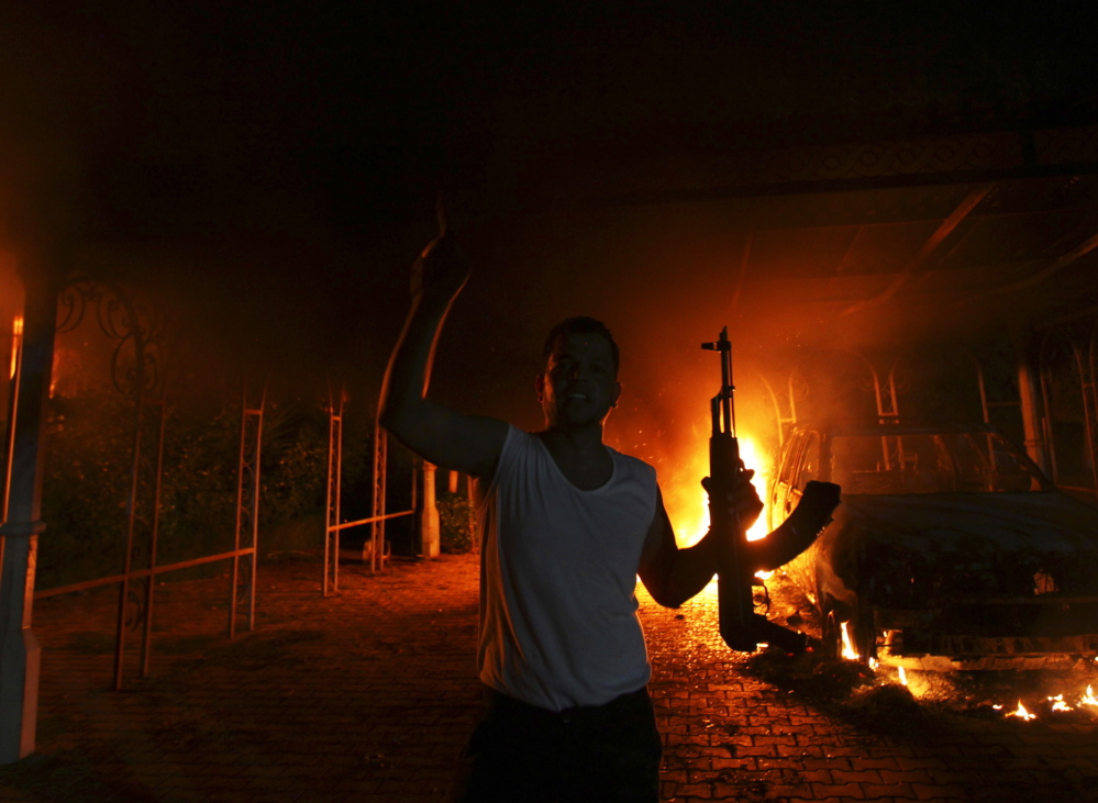 The U.S. Consulate in Benghazi is seen in flames on Sept. 11, 2012. CIA officials testified this week that a fear of ambush with no backup delayed the agency's response to the attack.