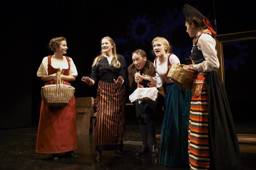 """Villagers exclaim over the first snowfall in a scene from the Portland Stage Company production of the Hans Christian Andersen fairytale """"The Snow Queen"""" continuing through Dec. 22"""