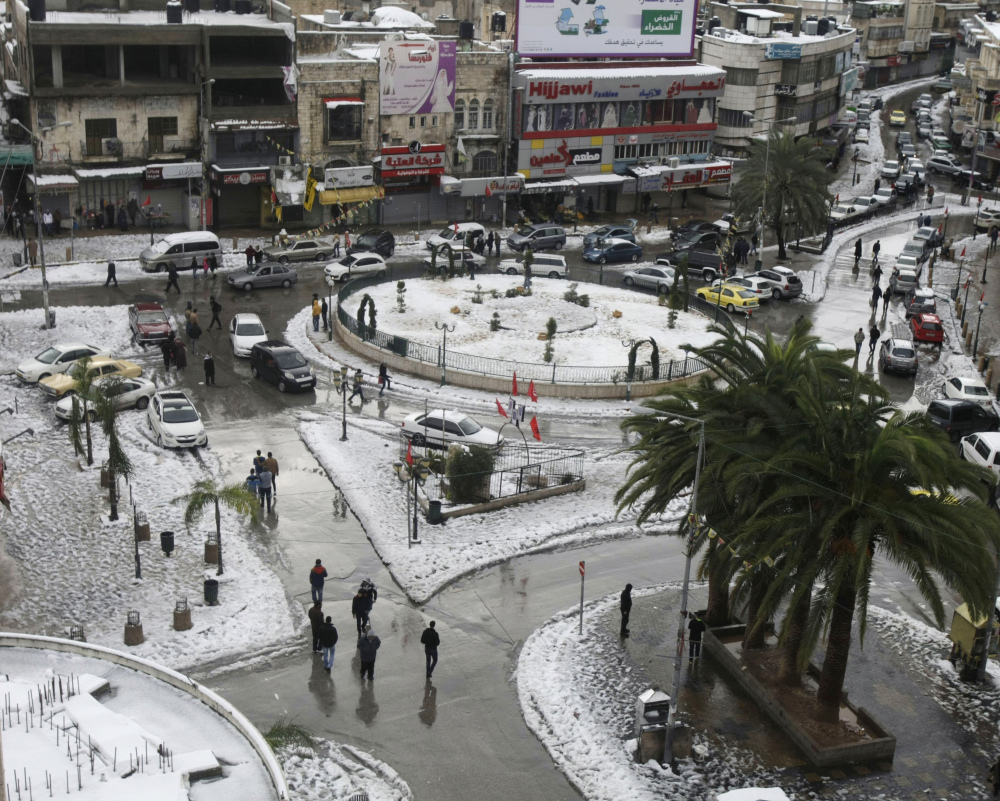Snow starts to collect in an area of the West Bank town of Nablus on Saturday. Four days of heavy rain forced evacuation of thousands in the Gaza Strip. Jerusalem, meanwhile, was brought to its knees by a foot of snow.