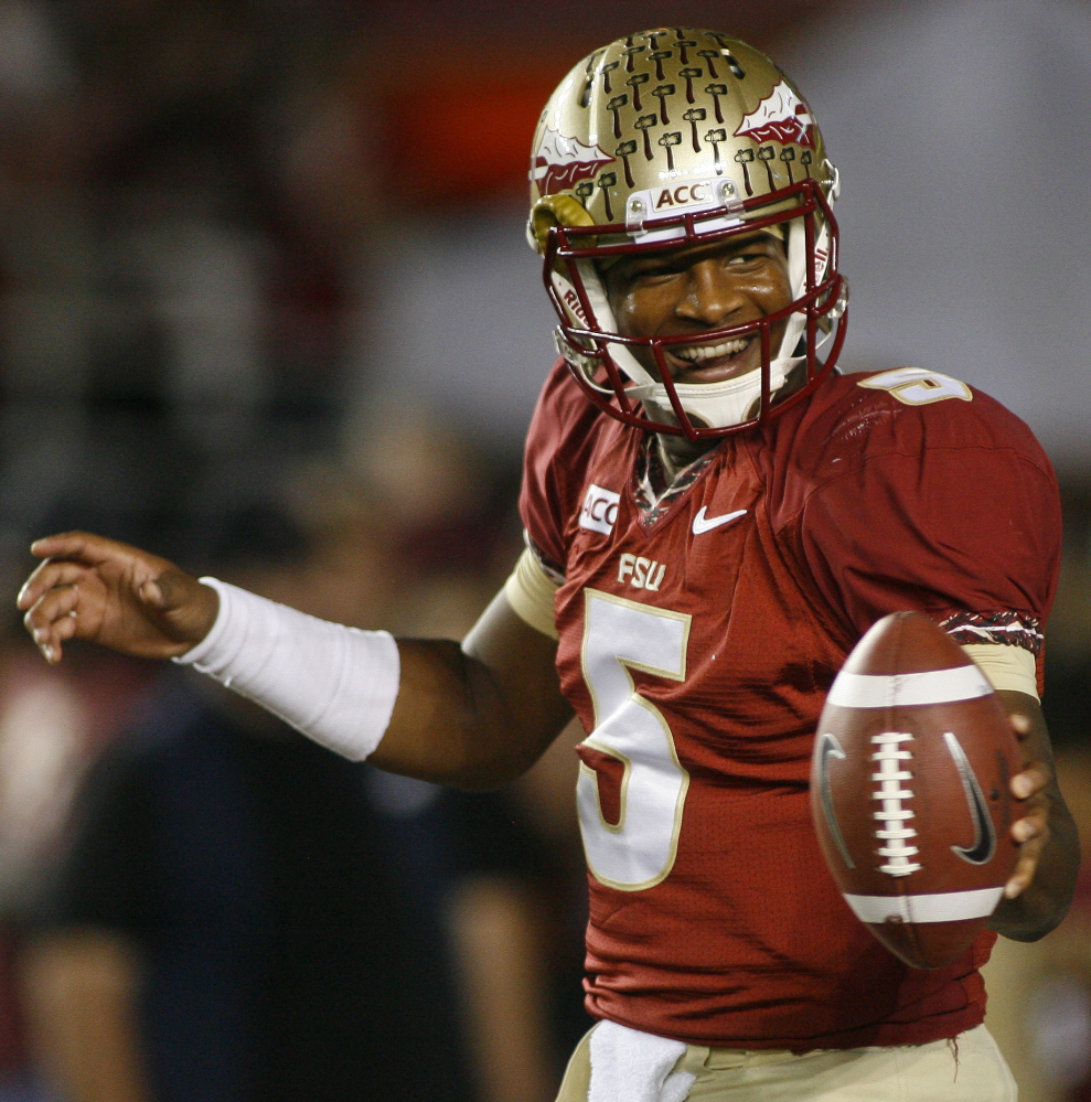 Florida State quarterback Jameis Winston became the youngest player to win the Heisman Trophy – given to college football's top player – on Saturday night at age 19.