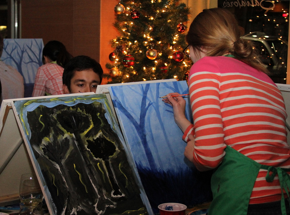Lattice Engines employees paint trees on canvas at a company holiday party earlier this month in Boston.