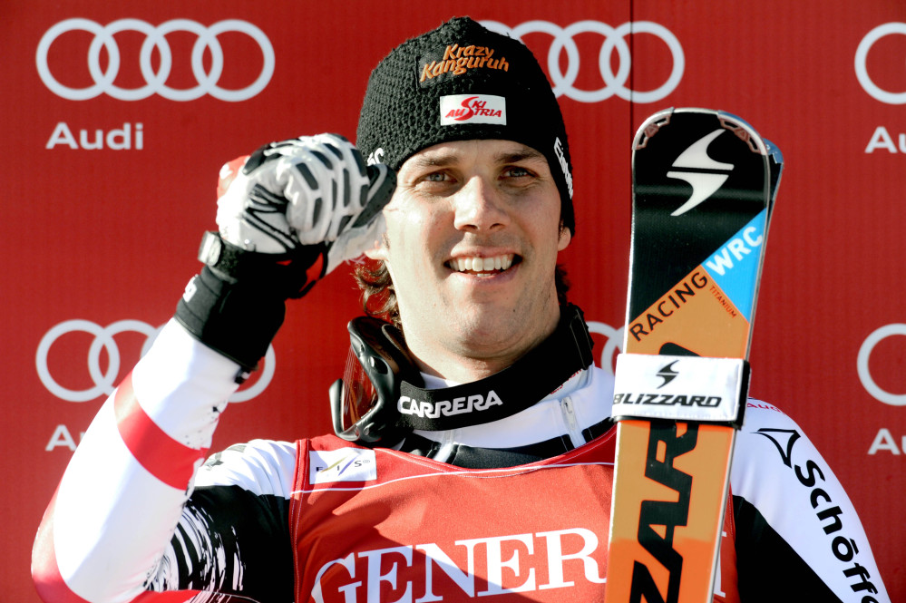 Austria's Mario Matt celebrates on the podium after winning an alpine ski, men's World Cup slalom, in Val d'Isere, France, Sunday, Dec. 15, 2013. Veteran Mario Matt of Austria safely protected his first-run lead to win a World Cup slalom race on Sunday. A two-time former slalom world champion, the 34-year-old Matt beat Sweden's Mattias Hargin by .53 seconds and Italian veteran Patrick Thaler, second after the first run, by .78.