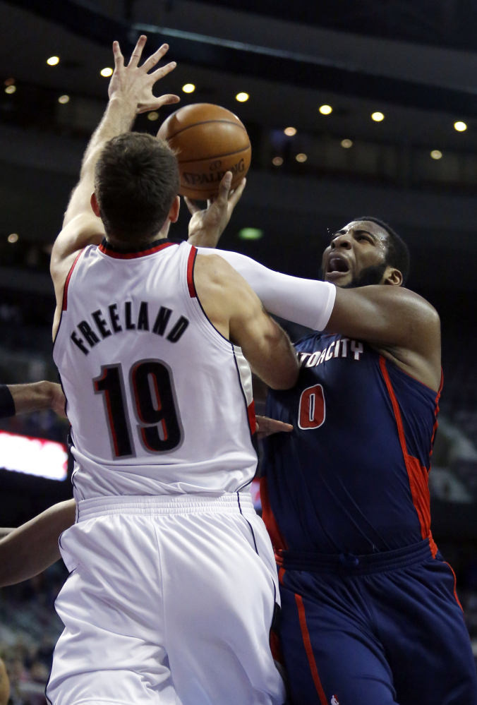 Detroit center Andre Drummond takes a shot against Portland center Joel Freeland during the first half of Sunday's game at Detroit, a 111-109 win for the Trail Blazers.