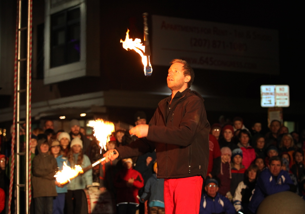 David Graham of the Red Trouser Show juggles fire in a performance Dec. 6 during the First Friday Art Walk in Portland.