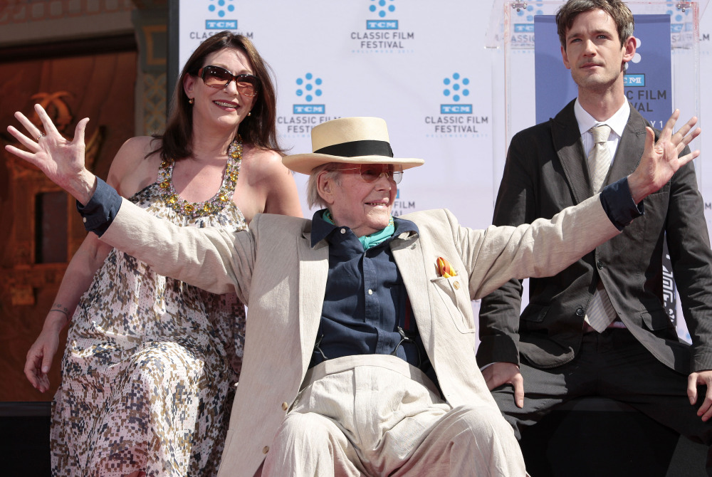 Actor Peter O'Toole, flanked by daughter Kate O'Toole and son Lorcan O'Toole, acknowledges onlookers during his hand and footprint ceremony at Grauman's Chinese Theatre in Los Angeles. O'Toole died Saturday at the age of 81.