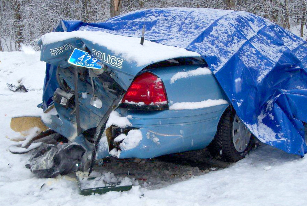 State Trooper Robert Cjeka was trapped in 2011 after being his cruiser was rear-ended in Livermore Falls. Police are urging motorists to slow down and move over when approaching emergency vehicles.