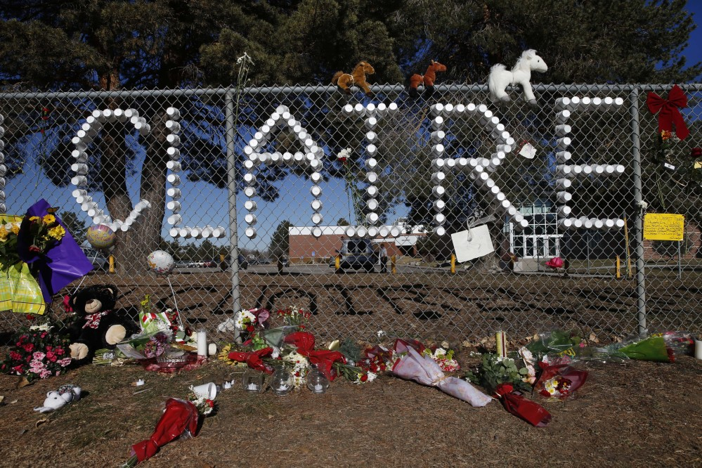 A makeshift tribute site bears the name of severely wounded student Claire Davis, who was shot by a classmate during school three days earlier in an attack, in front of Arapahoe High School in Centennial, Colo., Monday, Dec. 16, 2013. Davis, age 17, was shot in the head at close range with a shotgun, and remains in a coma.