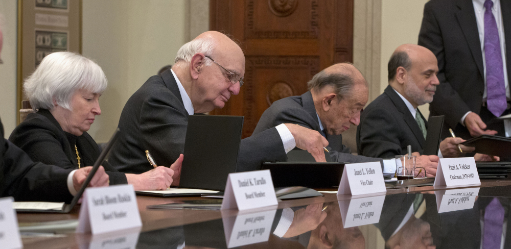 From left, Janet Yellen, President Obama's choice to head the Federal Reserve Board, former Chairman Paul Volcker, former Chairman Alan Greenspan and outgoing Chairman Ben Bernanke participate in the ceremonial signing of a certificate commemorating the 100th anniversary of the signing of the Federal Reserve Act, at the central bank in Washington.