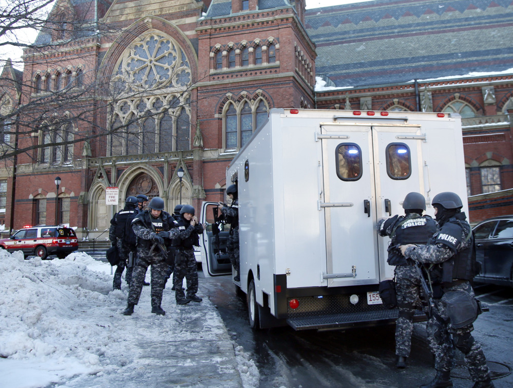 SWAT team officers arrive at a building in Harvard Yard at Harvard University in Cambridge, Mass., Monday, after campus police received an unconfirmed report that explosives may have been placed inside. No explosives were found.