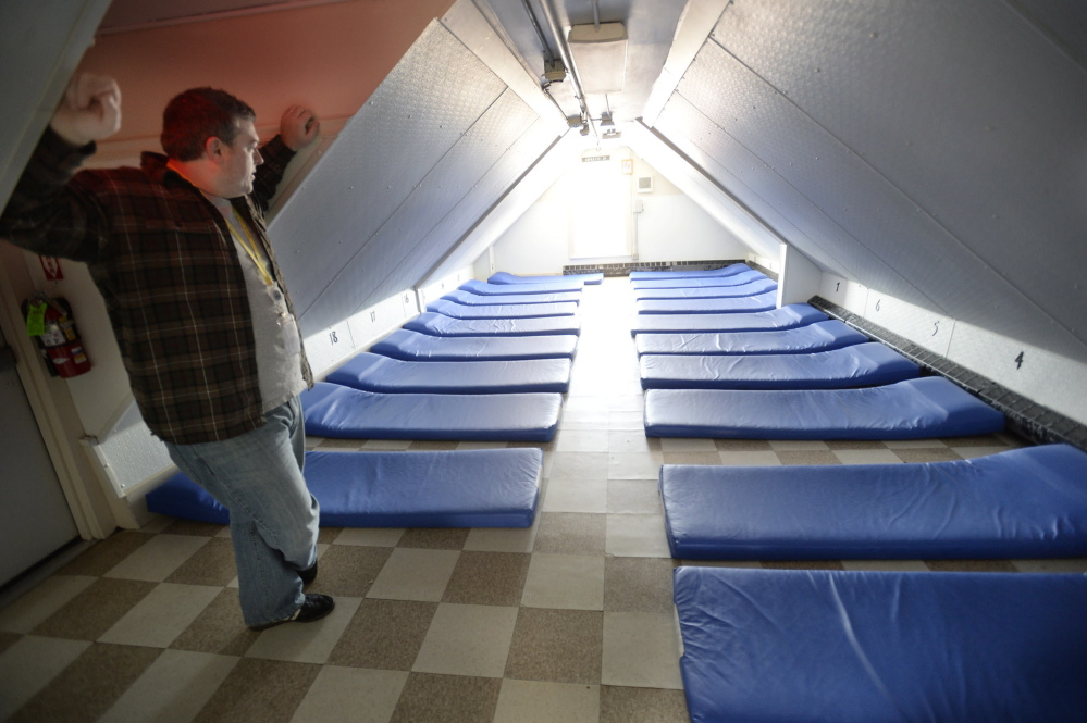 Robert Parritt, the assistant director, looks over one of the rooms at the Oxford Street Shelter that often fill up as people come in from the cold in Portland. The shelter can hold about 125 people on any given night.