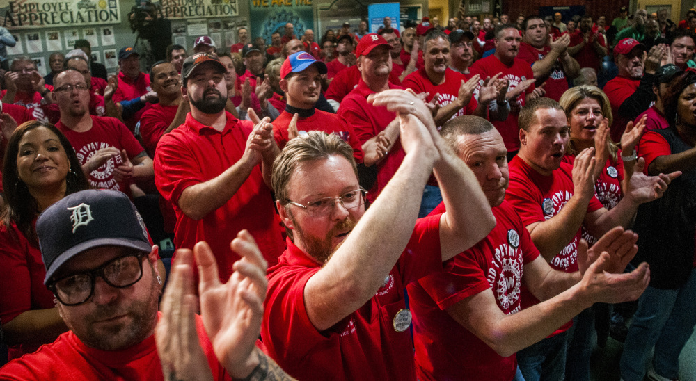 Union workers in Flint, MIch., celebrate General Motors' announcement Monday that the company is investing $1.2 billion in several factories. The automaker is revamping its paint shop and developing the industry's first 10-speed automatic transmission.