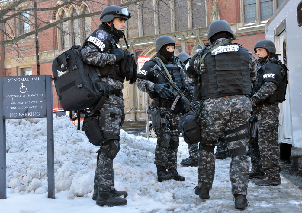 Tactical police assemble outside a building at Harvard University in Cambridge, Mass., Monday, Dec. 16, 2013. Four buildings on campus were evacuated after campus police received an unconfirmed report that explosives may have been placed inside, interrupting final exams.