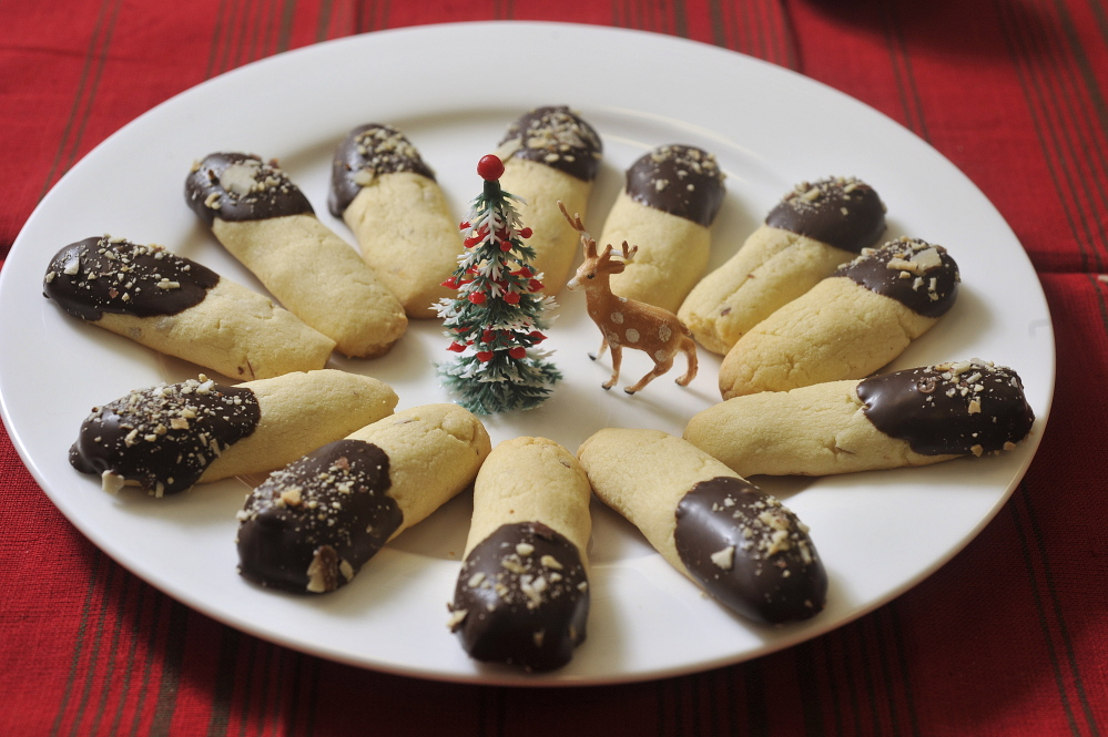 Kransekake Sticks Dipped in Chocolate made by Alexandra Daley-Clark of Lyman.
