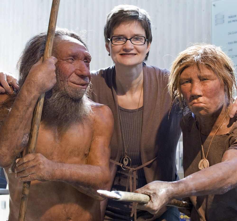 Baerbel Auffenmann, deputy museum director, poses with models of Neanderthals at the Neanderthal Museum in Mettmann, Germany, in 2009. DNA from an ancient toe bone suggests that Neanderthals mated with close relatives and with members of other hominid groups.
