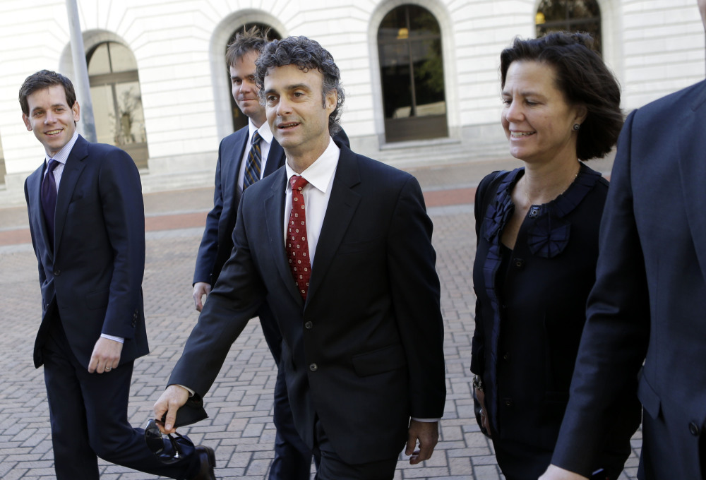 Kurt Mix, center, arrives with his legal team at Federal Court in New Orleans on Wednesday. A federal jury deliberated for more than nine hours since hearing closing arguments Monday before reaching a verdict of guilty on one count of obstruction of justice. The count carries a maximum sentence of 20 years in prison and a $250,000 fine.
