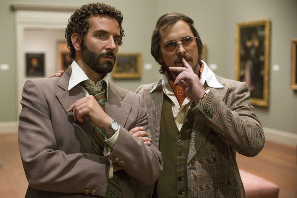 "Bradley Cooper, left, and Christian Bale in ""American Hustle."""
