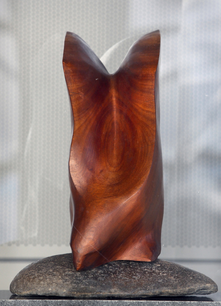 """""""Hawk,"""" wood and granite by artist Cabot Lyford."""