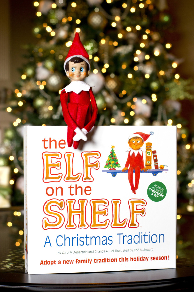 """The Elf on the Shelf: A Christmas Tradition"" book comes with an elf for the shelf. The elf serves as a scout for Santa and has to be moved stealthily every night, traditionally around Thanksgiving until Christmas Eve. The mission? To report back to the boss in red on who's been naughty or nice."