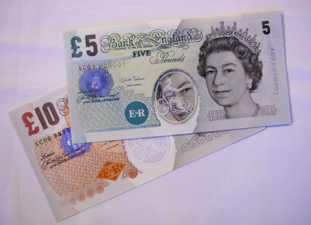 Examples of polymer banknotes are displayed at the Bank of England, in London, on Wednesday.