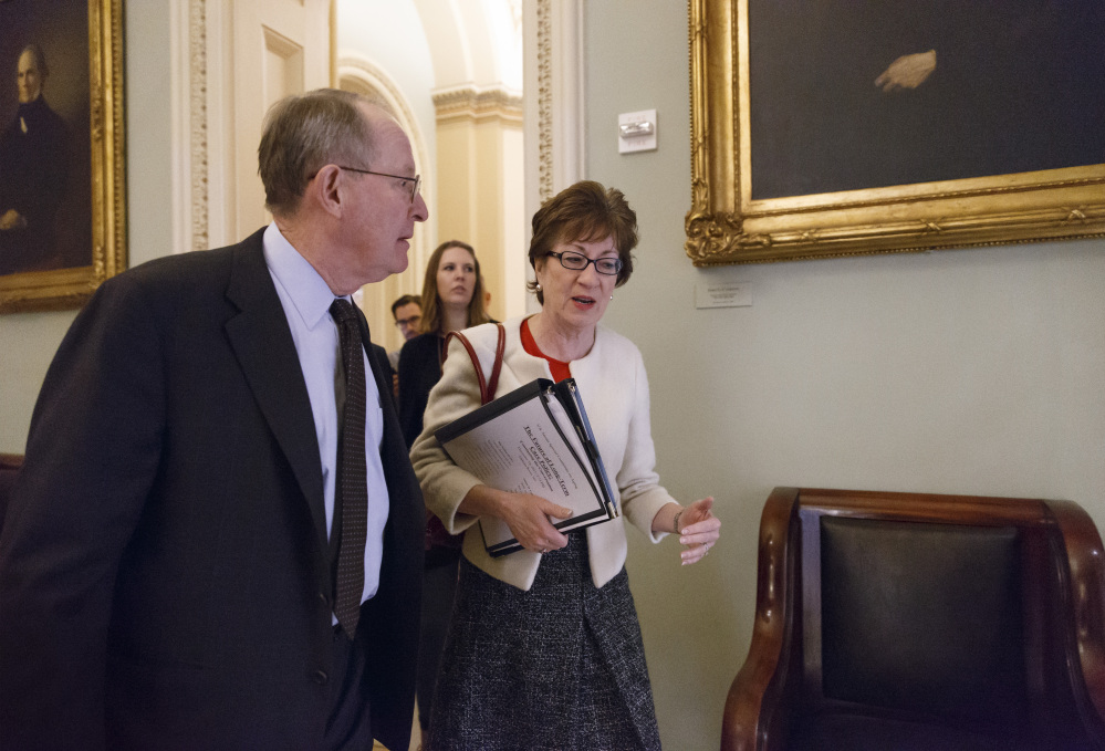 Sen. Lamar Alexander, R-Tenn., left, and Sen. Susan Collins, R-Maine, walk to a closed-door Republican meeting before the Senate moves to pass a modest, bipartisan budget bill, at the Capitol in Washington, Wednesday.