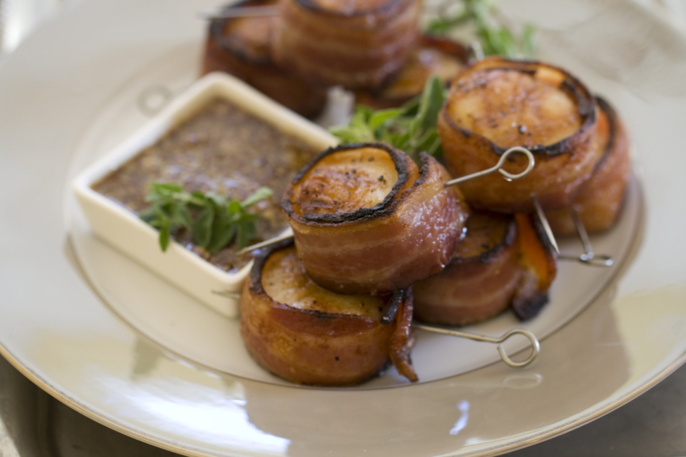 This Nov 4, 2013 photo shows grilled bacon wrapped scallops in Concord, N.H. This all-protein finger food appetizer is perfect for holiday entertaining.